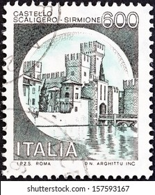 "ITALY - CIRCA 1980: A stamp printed in Italy from the ""Castles"" issue shows Scaliger Castle, Sirmione, circa 1980."