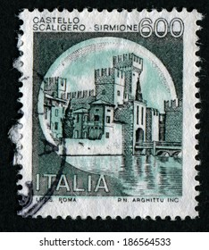 "ITALY - CIRCA 1980: A stamp printed in Italy from the ""Castles"" issue shows Scaliger Castle - Sirmione, circa 1980."