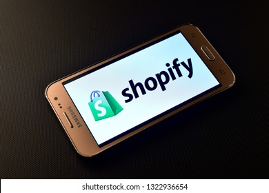 Italy - february 10, 2019: Shopify, Canadian e-commerce company logo in mobile, dropshipping concept