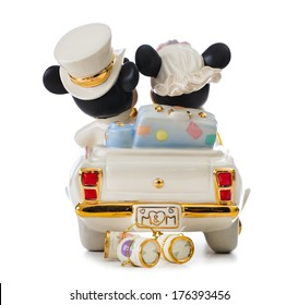 ITALY - FEBRUARY 12, 2014: Minnie's Dream honeymoon Disney, wedding cake topper by Lenox. The object is in porcelain 24 karat gold. Mickey Mouse and Minnie Mouse in the car are leaving for honeymoon.