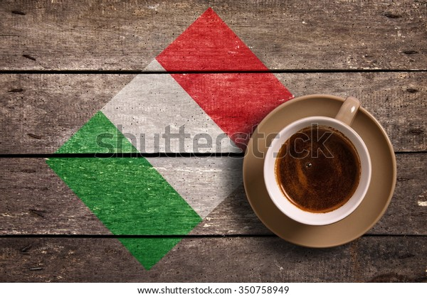 Italy flag with coffee on table. top view