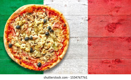 Italy flagged wooden Table with four seasons pizza. View from above