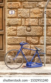 Italy, Florence, August 7, 2011: a bicycle without a rear wheel is parked at a pillar.