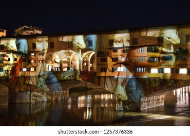 Italy, Florence, December 2018: The famous Ponte Vecchio of Florence illuminated in occasion of F-Light - Festival of Lights with the masterpieces of Leonardo da Vinci during the Christmas season.