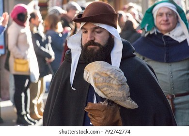Italy, Florence - January 6 2017: the view of the man in medieval costume holding predatory bird at traditional parade of Epiphany Befana, medieval festival in Florence on 6 January 2017, Tuscany.
