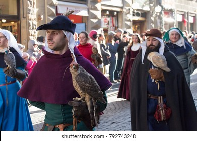 Italy, Florence - January 6 2017: the view of the men in medieval costume holding predatory birds at traditional parade of Epiphany Befana, medieval festival in Florence on 6 January 2017, Tuscany.