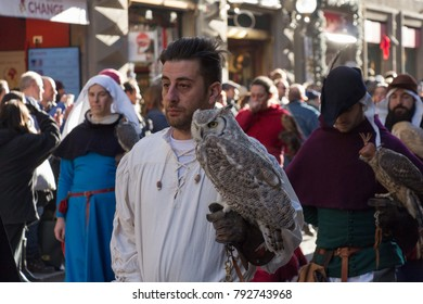 Italy, Florence - January 6 2017: the view of the man in medieval costume holding an owl at traditional parade of Epiphany Befana, medieval festival in Florence on 6 January 2017, Italy.