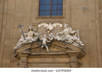 Italy, Florence - July 11, 2017: View on part of church Complesso di San Firenze (Complex of San Firenze). Faith and Hope with putti holding aloft the Sacred Heart, sculpted by Giovacchino Fortini.