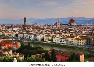 Italy Florence panoramic view on the city with cathedral , palace Vecchio, towers, domes, river Arno and other buildings at sunrise