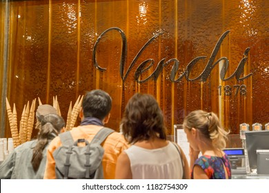 ITALY - FLORENCE - SEPTEMBER 3: People looks at the Venchi's gourmet chocolate store in Florence Italy on September 3 2018.