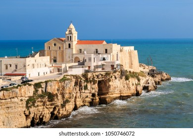 Italy, Foggia, Apulia, Gargano National Park,  Vieste. Old town of Vieste cityscape with medieval church of San Francesco at the tip of the peninsula of this fishing village in Gargano, Apulia, Italy.