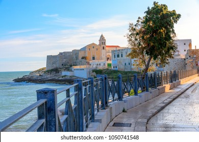 Italy, Foggia, Apulia, SE Italy, Gargano National Park,  Vieste. Old town of Vieste cityscape with medieval church of St. San Francesco at the tip of the peninsula.