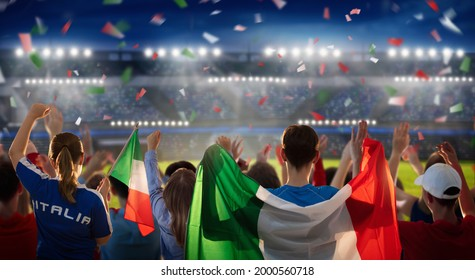 Italy football supporter on stadium. Italian fans on soccer pitch watching team play. Group of supporters with flag and national jersey cheering for Italia. Championship game. Forza Azzurri! - Shutterstock ID 2000560718