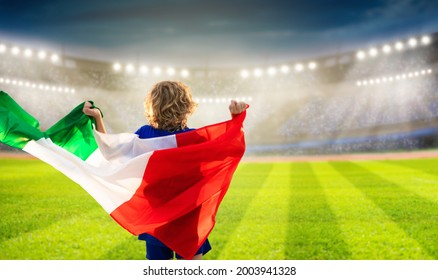 Italy football supporter on stadium. Italian fans on soccer pitch watching team play. Group of supporters with flag and national jersey cheering for Italia. Championship game. Forza Azzurri - Shutterstock ID 2003941328