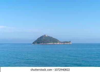 Italy, Gallinara Island, Italian Riviera, distant view