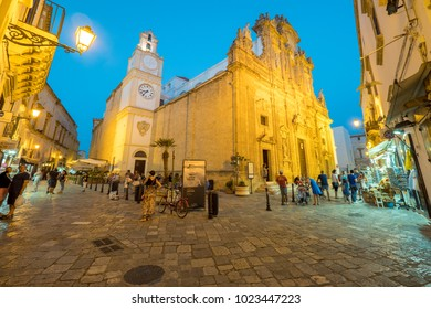 ITALY - GALLIPOLI, CIRCA JUN 2017: Classic scenario of old city Gallipoli in walk way during twilight in Gallipoli, Puglia, Italy.