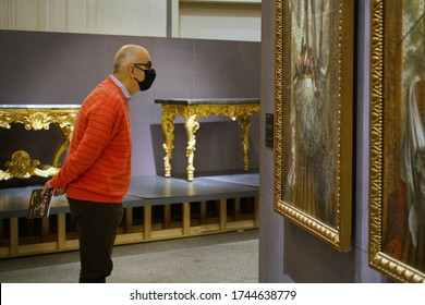 "Italy has eased the lockdown measures for the Covid-19 pandemic and many museums are reopening. Visitors look at the artworks of the exhibition ""Defying the Baroque"". Turin, Italy - May 2020"