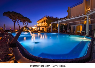 Italy, Ischia - July 4 2017: Luxury hotel 5 star San Montano and thermal pool at night