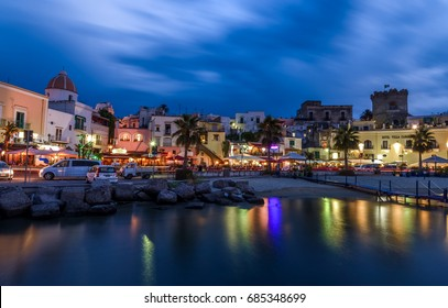 Italy, Ischia - June 28, 2017: Night view of the promenade of Forio and reflection of lanterns in the sea.