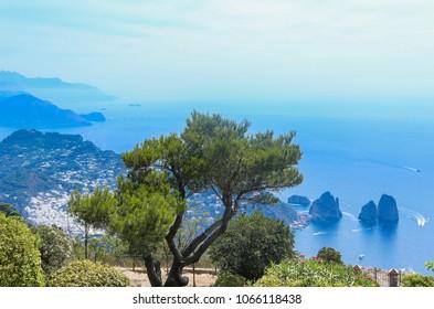 Italy. Island Capri. Faraglioni rocks and boats from Monte Solaro, in Anacapri
