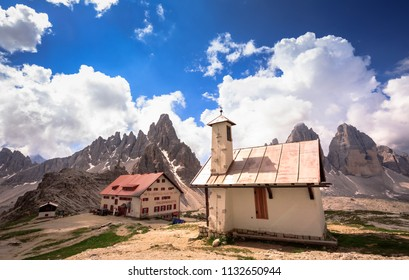 ITALY- JUNE 19, 2018: The buildings and The tre cime mountain peak in summer