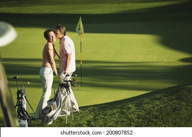 Italy, Kastelruth, couple standing on golf course