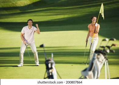 Italy, Kastelruth, Golfers playing golf on golf course