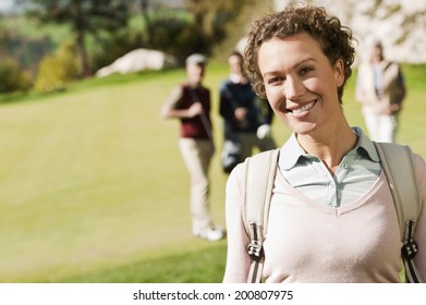 Italy, Kastelruth, woman on golf course smiling