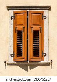 Italy Levico Barn Door Window Shutters Teak on Cream Color Wall