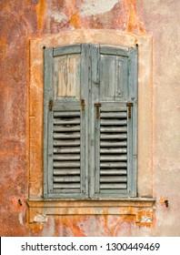 Italy Levico Barndoor Window Shutters Grey Teak on Orange Wall