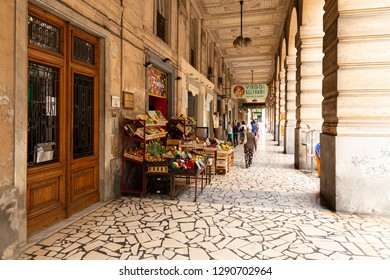 Italy, Liguria, La Spezia, Via Vittorio Veneto 74. 11th of June 2018. View along one of the arcades in the center of the city with a small vegetable shop.