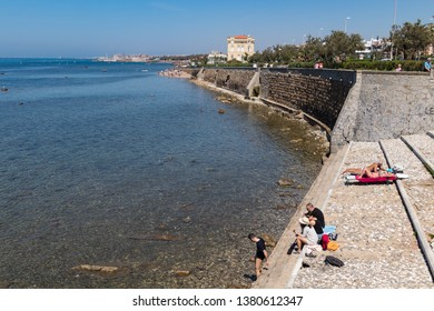 ITALY, LIVORNO - APRIL 22, 2018 - Beautiful Livorno urban sea: people tanning and relaxing