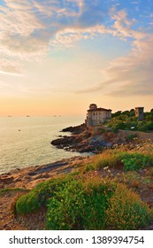Italy, Livorno, July 2018 marine landscape of the Livorno coast in the area of Antignano in Tuscany with the Castello del Boccale in the background built by the Medici in the 16th century