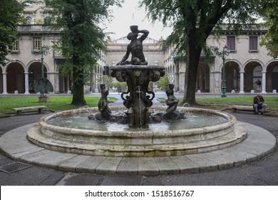 ITALY, LOMBARDY, BERGAMO - 22 September 2019: fountain from piazza Dante Lavori (fontana da piazza Dante Lavori) Bergamo Citta Bassa.The large marble basin surmounted by the god Neptune with sea horse