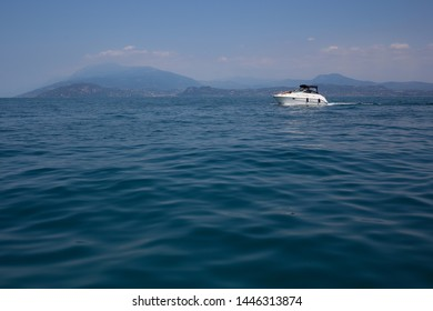 ITALY, LOMBARDY, GARDA LAKE - 29 June 2019: motorboat on the Garda lake