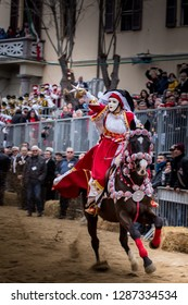 ITALY -Masked horsemen participate to the traditional race to the star of Sa Sartiglia, the carnival of the city Oristano in Sardinia on February 11, 2018