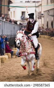 ITALY - Masked horsemen wearing a traditional costume gathers the star riding at the traditional race to the star of Sa Sartiglia, the carnival of the city Oristano in Sardinia on February 15, 2015