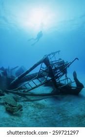 Italy, Mediterranean Sea, diver and a sunken ship wreck - FILM SCAN