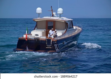 Italy, Mediterranean Sea, Fiumicino (Rome); 6 July 2005, couple fishing on board of a Portland 55 Lobster ABATI YACHTS luxury yacht - EDITORIAL