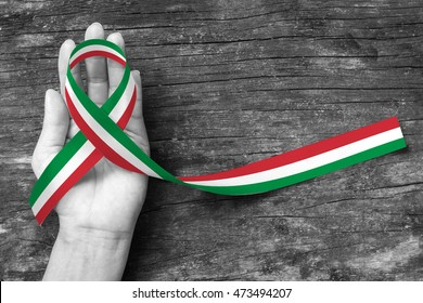Italy or Mexico national flag color ribbon pattern on people's hand (isolated  with clipping path) for Italian or Mexican nation support and holiday festival