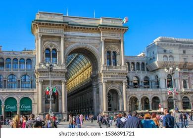 Italy, Milan - April 25, 2013: Many tourists walking around the Galleria Vittorio Emanuele II entrance in Milan
