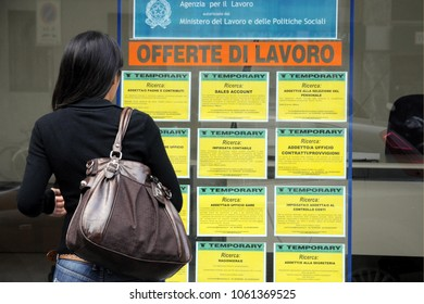 Italy - Milan  April4,2018 - job offers - girl in front of the window of an agency for temporary work, unemployment and economic crisis