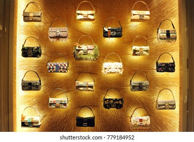Italy - Milan dicember 21,2017 - Fendi boutique - luxury store in Montanapoleone road - bags in a gold background
