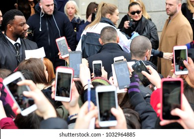 Italy - Milan february 25,2018 -  shooting with the phone - fans resume the event by taking pictures and videos with the phone