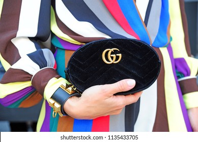 Italy - Milan july 16,2018 - Gucci dark and little ( Hand ) bag ( pochette ) with colored dress - outfit and italian style - fashion