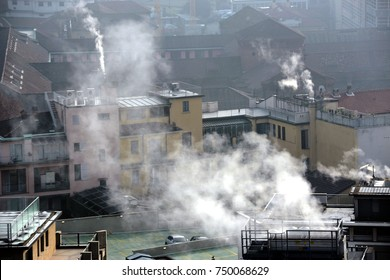 Italy - milan - lombardy - smog pollution - chimney smoke caused by heating the houses