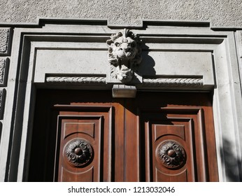 Italy, Milan. Made of stone and located on a marble arch, aroud 300 years old. Fallen angel in the shape of a roaring lion or a daemon on a door
