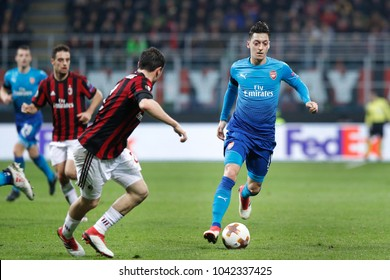 Italy, Milan, march 08 2018: Ozil Mesut dribbles followed by Calabria Davide in first half during football match AC MILAN vs ARSENAL, Europa League 2018 round of 16 at San Siro stadium