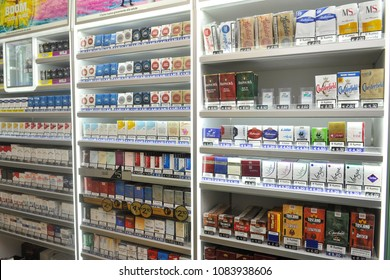 Italy - Milan may 5,2018  - tobacconist - tobacco and cigarette packs of various brands on display for sale - tax increase on smoking
