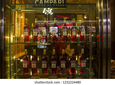 ITALY, MILAN - November 1, 2018: Store display with bottle rows of Campari Bitter Liqueur in Milan